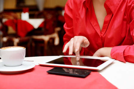 Woman with tablet computer in cafe shop photo