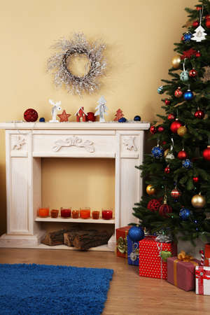 Beautiful Christmas interior with  decorative fireplace and fir tree photo