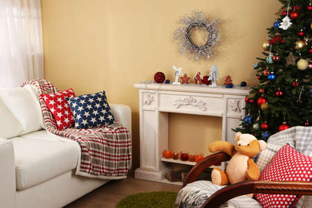 teddy wreath: Beautiful Christmas interior with decorative fireplace and fir tree