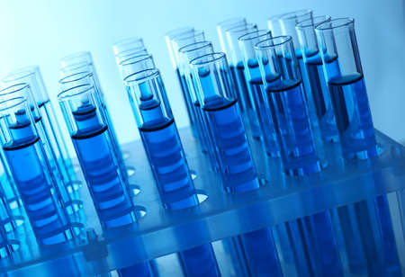 testtube: Blue water in a transparent test-tube on light background