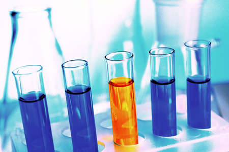 liquidity: Test-tubes filled with color fluid close-up