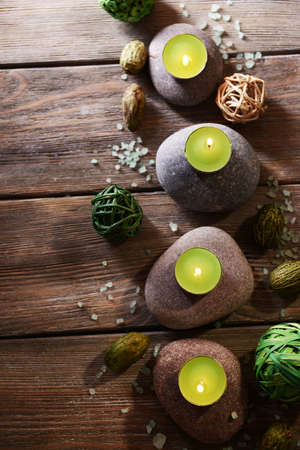 stone therapy: Composition of spa treatment on wooden