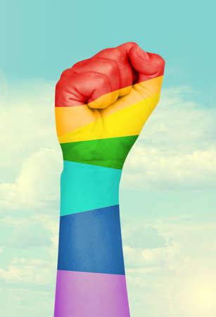 Man hand painted as the rainbow flag on sky  photo