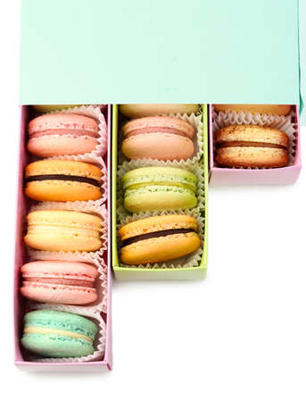 Gentle colorful macaroons in box isolated on white photo