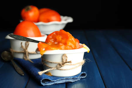 persimmons: Ripe sweet persimmons, on wooden table