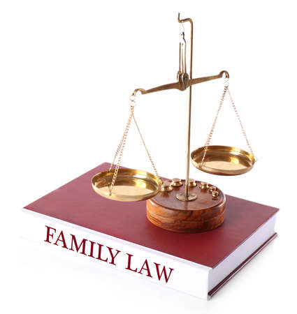 divorce court: Scale on FAMILY LAW book isolated on white