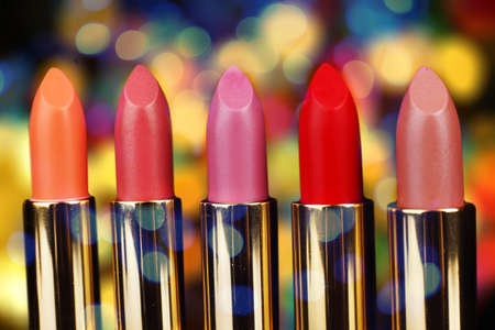 red lipstick: Set of lipsticks on bright colorful background