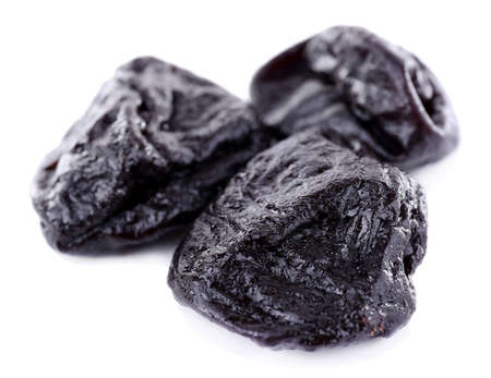 prunes: Three prunes isolated on white