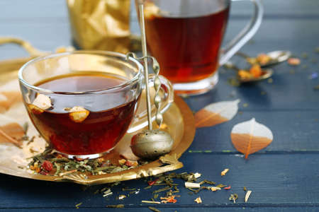infuser: Beautiful vintage composition with herbal tea, on wooden table Stock Photo
