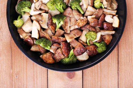 braised mushrooms: Braised wild mushrooms with vegetables and spices in pan on table Stock Photo