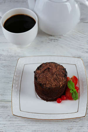 Yummy chocolate cupcake on table photo