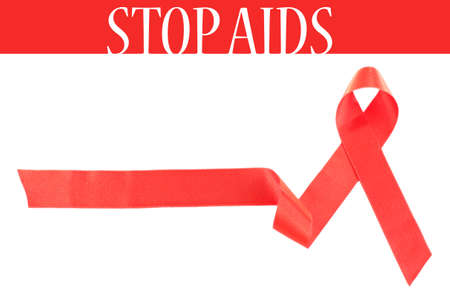 health care funding: Red AIDS ribbon isolated on white Stock Photo