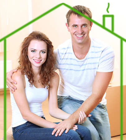 Loving couple in drawing house photo