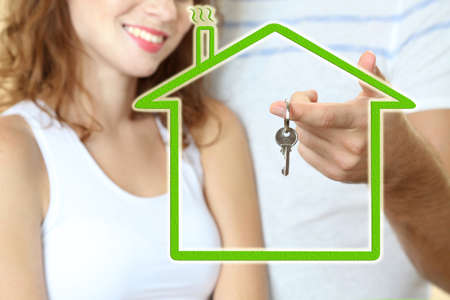 loving couple: Loving couple with keys in drawing house Stock Photo