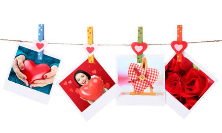 Photo cards hanging on the clothesline isolated on white, Valentines Day concept photo