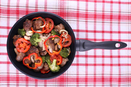 braised mushrooms: Braised wild mushrooms with vegetables and spices in pan on tablecloth