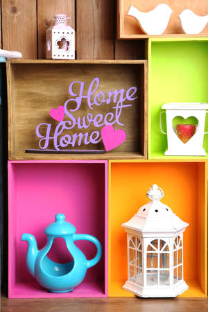 Beautiful colorful shelves with different home related objects, close-up photo