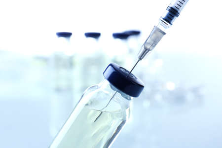 Vaccine in vial with syringe