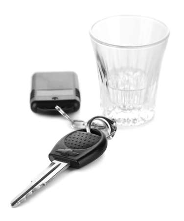Glass of alcoholic drink and car key, isolated on white photo