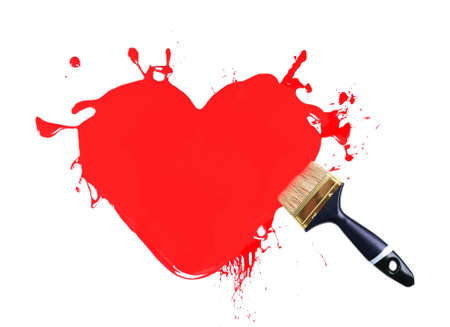 Heart made of red paint splashes and paintbrush isolated on white photo