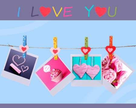 Photo cards hanging on the clothesline on blue background, Valentines Day concept photo