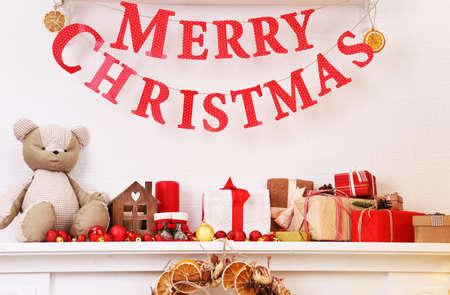 mantelpiece: Christmas decoration on mantelpiece on white wall background