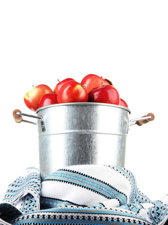 dishcloth: Pail filled with red apples and dishcloth on light background Stock Photo