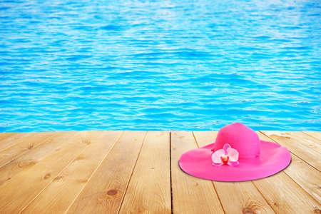 Summer hat on sea background photo