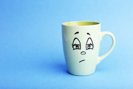 opinionated: Emotional cup on blue background
