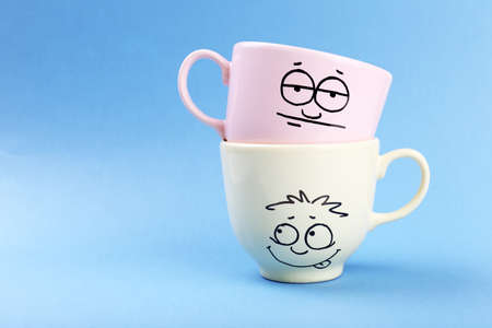 opinionated: Emotional cups on blue background