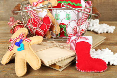 Handmade Christmas decorations, old letters on wooden background photo