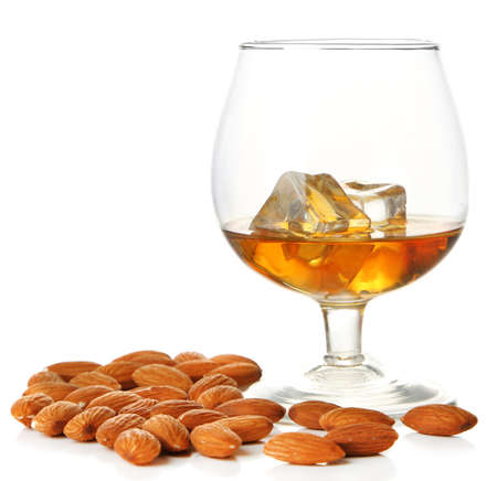 Dessert liqueur Amaretto with almond nuts, isolated on white Stock Photo