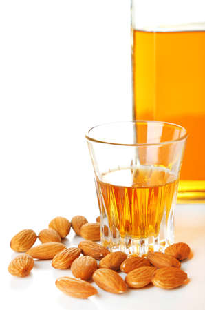amaretto: Dessert liqueur Amaretto with almond nuts, isolated on white