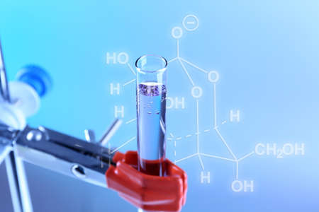 fixed: Fixed test tube on support on light blue background Stock Photo