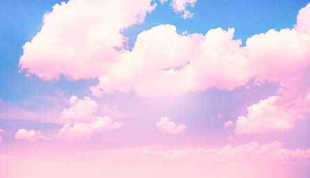 blue violet bright: Blue sky background with pink clouds