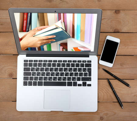 digital library: E-learning concept.  Digital library - books inside laptop Stock Photo