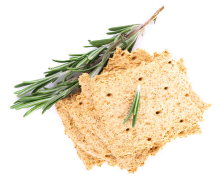 sprigs: Crispbread with sprigs of rosemary isolated on white background