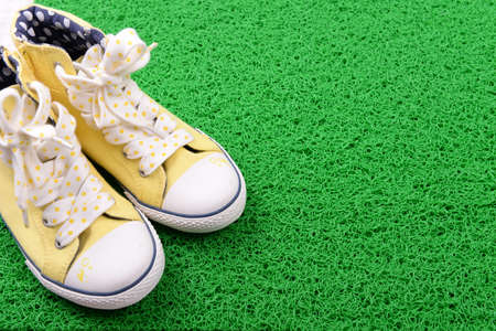 converse: Green carpet and converse close-up