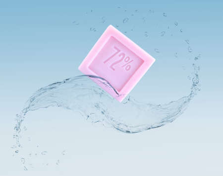 glycerol: Aromatic pink soap in water splash on blue background