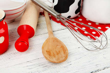 Kitchen utensils for baking on color wooden background photo