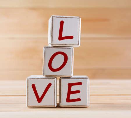 spelled: Love spelled in wooden blocks Stock Photo