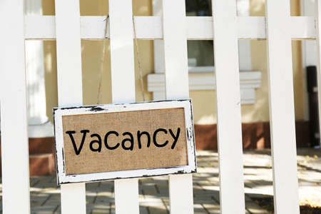 holidays vacancy: Signboard with text Vacancy near hotel