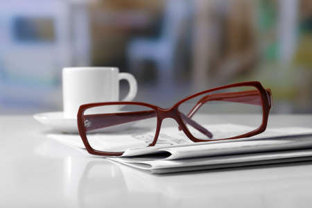 everyday jobs: Glasses and newspapers, close-up