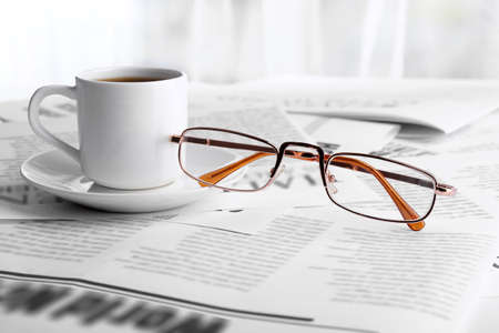 daily newspaper: Glasses and newspapers, close-up