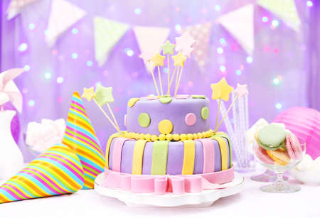 pink cake: Delicious birthday cake on shiny purple background