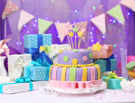 birthday cakes: Delicious birthday cake on shiny purple background