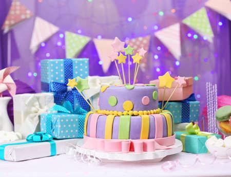 cream cakes: Delicious birthday cake on shiny purple background