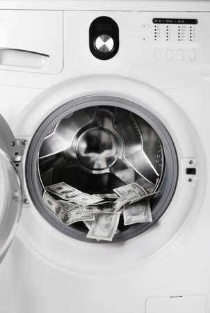 scammer: Money in washing machine, closeup view