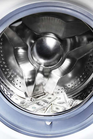 Money in washing machine, closeup view photo