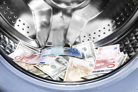 pecuniary: Money in washing machine, closeup view